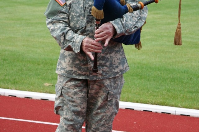Retired Master Sgt. Merrit Powell, bagpiper for 2nd SCR, played for the deployment ceremony Aug. 3.