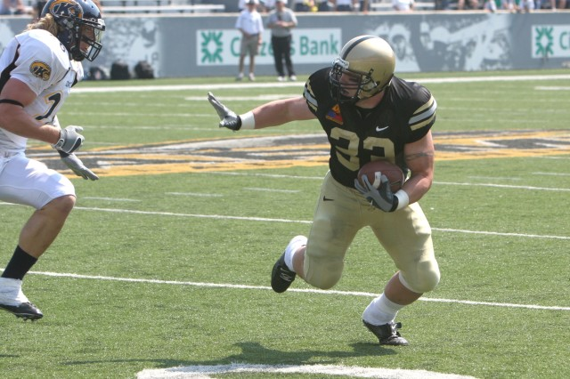 Mike Viti, team captain and fullback from Berwick, Pa., fends off a tackler during West Point\'s game against Kent State last year. The Army Athletic Association will kick off the football season with Military Appreciation Day during West Point's Sept. 8 contest against Rhode Island at historic Michie Stadium.