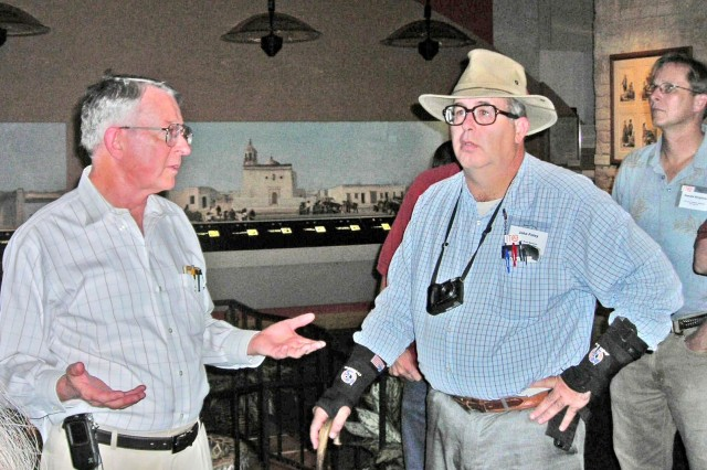 Director John Davis (left), from the Institute of Texan Cultures, explains the mission of the institute to John Foley (right) during a field trip to the Institute of Texan Cultures in San Antonio.