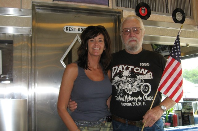 Air Force veteran Chuck Adams (right) poses with 'Walk A Mile for A Soldier' organizer Marcia Hawkins.