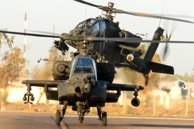 "Two AH-64D Apache helicopters from 1st ""Attack"" Battalion, 227th Aviation Regiment, 1st Air Cavalry Brigade, 1st Cavalry Division, taxi back to their parking spots at Camp Taji, Iraq, after completing a mission Aug. 15. The battalion supports ground troops through reconnaissance and aerial weaponry. The Apache crews of 1st ACB have disrupted numerous roadside bomb attacks aimed at Iraqi civilians and coalition forces throughout the Baghdad area of operations."