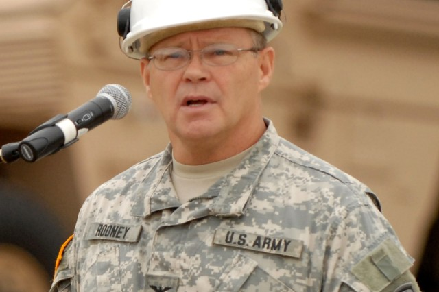 Army Col. John Rooney, commander of Army Test and Evaluation Command, speaks to visitors on Aberdeen Proving Ground, Md., before an orientation of the mine-resistant ambush-protected vehicle, or MRAP, August 24, 2007.