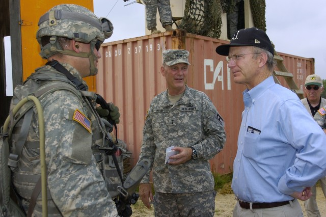 Maj. Gen. Jay Hood, 1st Army East commanding general, and Secretary of the Army Pete Geren talk with a Soldier who participated in the Combat Defensive Patrol Exercise.