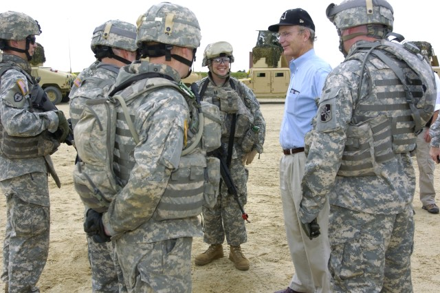 Secretary of the Army Pete Geren talks with Soldiers after viewing their Combat Defensive Patrol Exercise.