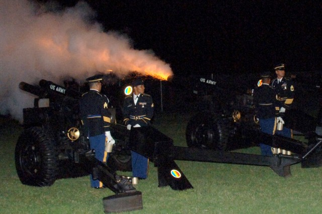 "Soldiers of the TRADOC Salute Battery provide synchronized cannon fire during the playing of Tchaikovsky's ""1812 Overture"" - one of the closing selections for the Aug. 23 Music Under the Stars Concert at Fort Monroe, Va. The annual event draws thousands of spectators from the local area. The concert also featured the U.S. Army Golden Knights and the TRADOC Band. (Photo by Patrick Buffett)"