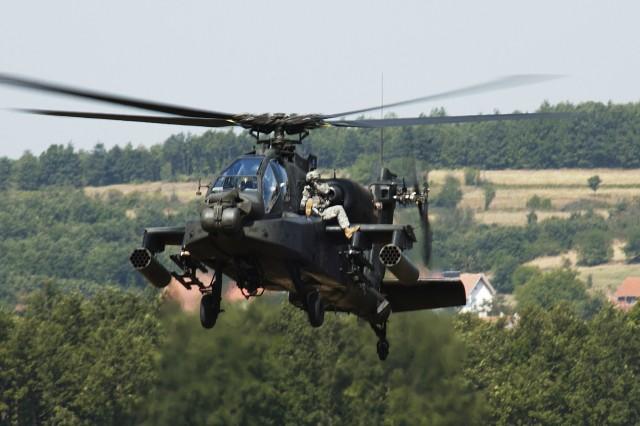 A Multi-National Task Force (East) Soldier rides shotgun