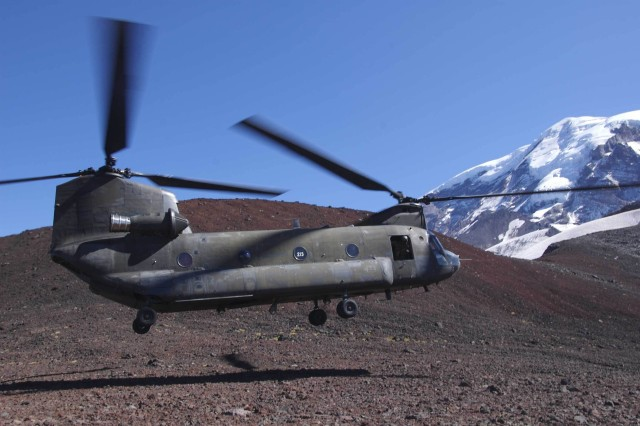 A CH-47 Chinook helicopter of the Fort Lewsi, Wash.-based Co. A  5th Battalion, 159th Aviation Regiment, prepares to land on a saddle 8,000 feet up the western face of Washington's 14,4000-foot Mount Rainier. The company, which is tasked with supporting the National Park Service in conducting high-altitude rescues above 8,000 feet on the dormant volcano, was conducting a  joint training exercise with the rangers who undertake the high-altitude rescues.