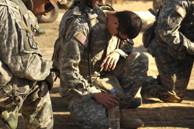 Soldiers from the 1st Cavalry Division pray prior to a foot patrol in Khalis, Iraq.