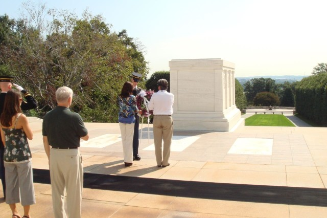 Laying a 'Walk a Mile for a Soldier' wreath at the tomb of the unknown Soldier.   Prayers for our fallen heroes.