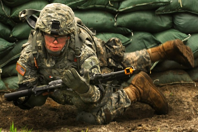 A New Mexico Army National Guard Soldier maneuvers around an obstacle.