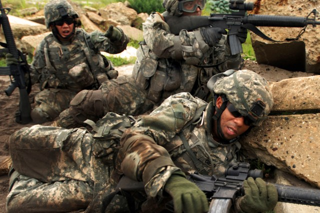 Soldiers from the California Army National Guard take defensive action.