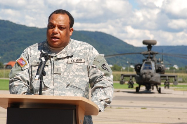 Chief Warrant Officer 5 Noel C. Seale, commander of the Army Flight Operations Detachment, speaks at the detachment's 50th anniversary celebration Aug. 23.