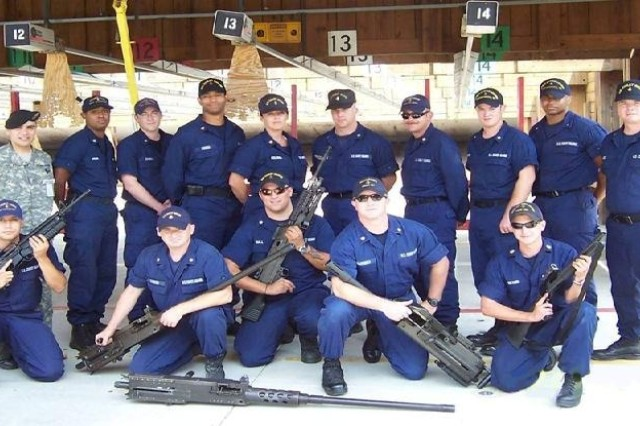 Sgt. 1st Class Kenneth B. Salazar (back row far left), new equipment training instructor, poses for a class photo with gunner's mates that he and James Quillin (not pictured) trained on small arms weapons maintenance and repair at the U.S. Coast Guard Station, Portsmouth Harbor, Vir., Aug. 11-24.  U.S. Army Photo by James Quillin