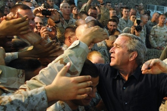 President Bush, speaking to Soldiers and other servicemembers at Al Asad Air Base, in Anbar Province, Iraq, Sept. 3.