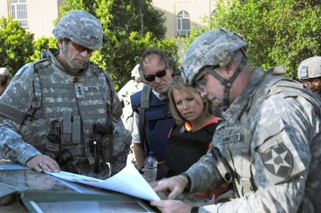 Katie Couric, anchor and managing editor of the CBS Evening News, speaks with Lt. Gen. Raymond T. Odierno, commander, Multinational Corps - Iraq and Col. Jeffrey Bannister, commander, 2nd Brigade Combat Team, 2nd Infantry Division, during a visit with Soldiers in the Rusafa district of Baghdad, Sep. 2. News media from the United States and other countries interview men and women of the armed forces in combat areas every day, and some are embedded within military units.