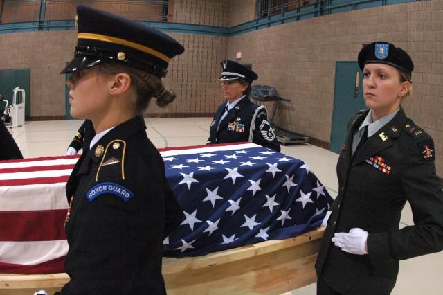 From right, Army 2nd Lt. Moranda Flemmer, Senior Master Sgt. Karen F. Erickson and Spc. Misty Breland carry a training casket.