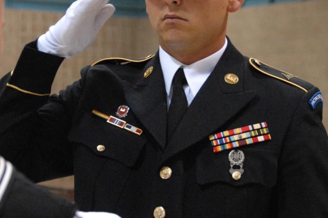 Spc. David Saari renders a salute.
