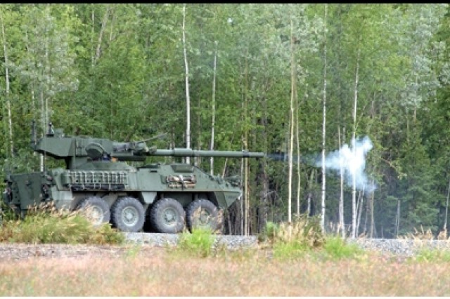 The Mobile Gun System fires high explosive anti-tank (HEAT) rounds at targets on the Digital Multipurpose Training Range at Fort Wainwright. Troops from the 1st Stryker Brigade Combat Team, 25th infantry Division, trained on the MGS this month.
