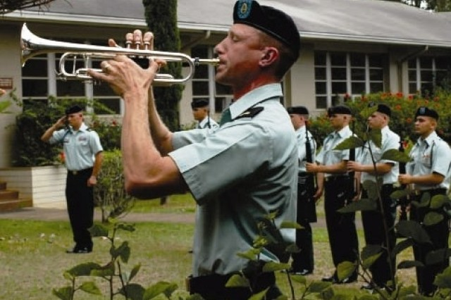 Sgt. James P. Sproul, 25th Infantry Division Band, plays taps, Wednesday, in memory of the 10 Tropic Lightning Soldiers killed in the UH-60 Black Hawk accident, Aug. 22.