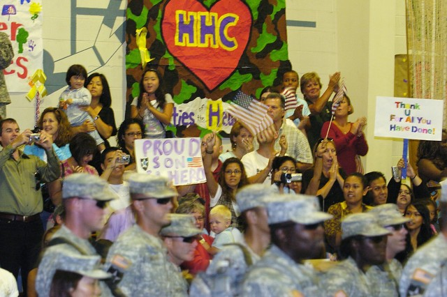 Sept. 4, 2007.  The crowd cheers as Soldiers from the 3rd Brigade, 2nd Infantry Division advanced party, arrive at Fort Lewis' Sheridan Gym after a 15-month tour in Iraq.