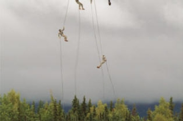 Air Assault students make their first rappel from Alaska National Guard UH-60 Black Hawk helicopters Aug. 23 as part of the 10-day class taught by a mobile training team from the National Guard Warrior Training Center, Fort Benning, Ga.