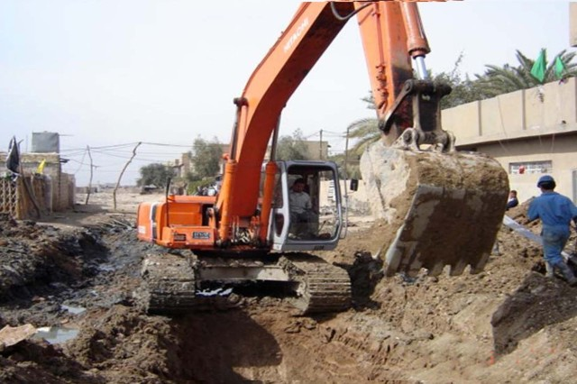 Iraqi workers dig a new sewer system in Oubaidi, a neighborhood in Baghdad. Before the sewer project was completed raw sewage collected in the streets causing health hazards for residents. The new sewer collection system is now fully operational, having recently been completed by the Gulf Region South district of the U.S. Army Corps of Engineers.