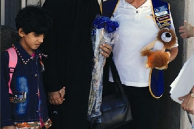 Zahraa and her grandmother are welcomed to Wisconsin by members of the Lions Club. Zahraa is a near-blind 7-year-old Iraqi. She was brought to America for treatment with the help of Sgt. 1st Class Johnny Kempen, a 1st Stryker Brigade Combat Team, 25th Infantry Division Soldier. The first of her two corneal transplants was Aug. 28.