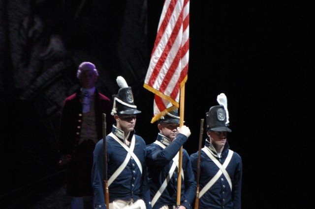 During the finale of the 2007 premiere of Spirit of America, period actors from Company A, 1st Battalion, 3rd U.S. Infantry Regiment (The Old Guard), march onto the Manchester, N.H., stage with national colors of an earlier era.