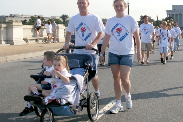 """Army Sgt. Larry Miller walks across Memorial Bridge with his wife Holly and two children, Jacob, 5, and Kyla, 4. """"It's personal for me,"""" Sgt. Miller said of the Freedom Walk. """"I wanted to be here because this is a good event and a"""