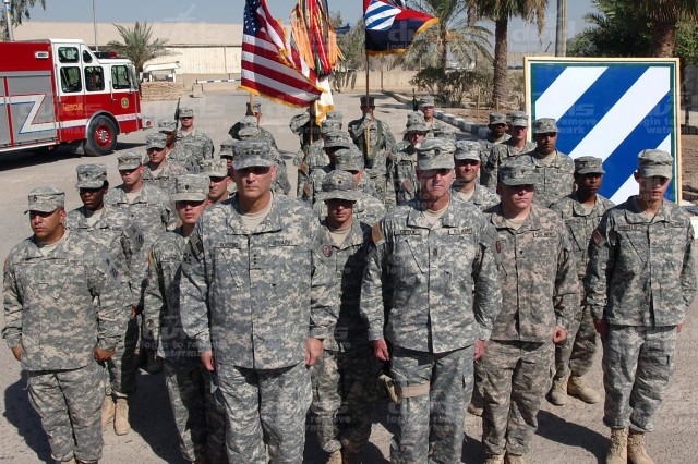 Task Force Marne Soldiers reflect during the solemn occasion.