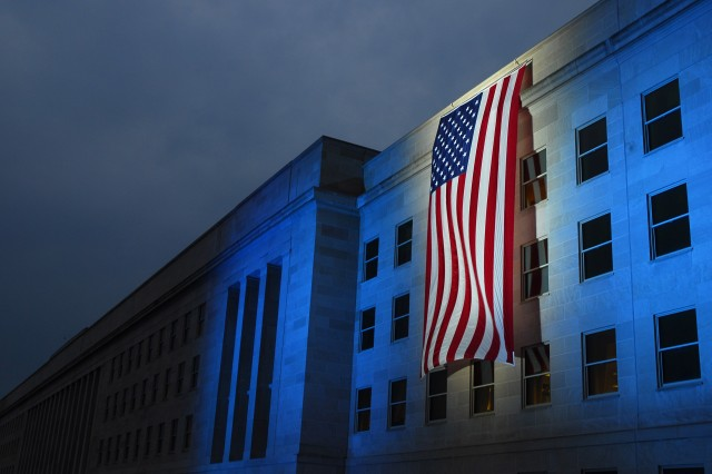 A memorial flag is illuminated, Sept. 11, 2007, near the spot where American Airlines Flight 77 crashed into the Pentagon six years ago. Defense Secretary Robert Gates will host a Pentagon Sept. 11 Memorial observance today.