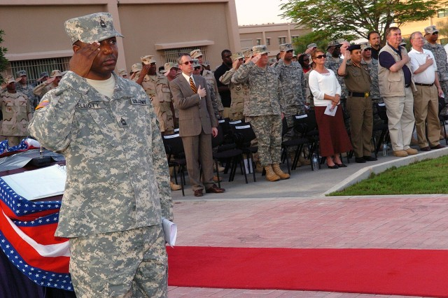 U.S. Army Master Sgt. John M. Elliot, from New Haven, Conn., salutes the U.S. flag during the playing of the National Anthem at Camp As Sayliyah's Patriot Ceremony on Sept. 11, 2007. Service members in Qatar paid tribute to the innocent victims slain in the attacks of Sept. 11, 2001 while serving from a forward deployed location off the Persian Gulf.