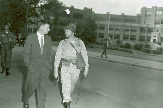 William Kuhn, commander 327 Airborne Battle Group, commander of the 101st Airborne Division troops deployed to Little Rock., walks with Little Rock Mayer, Woodrow Wilson Mann likely discussing security details surrounding the Little Rock 9.    U.S. Army Military History Institute Army Heritage and Education Center
