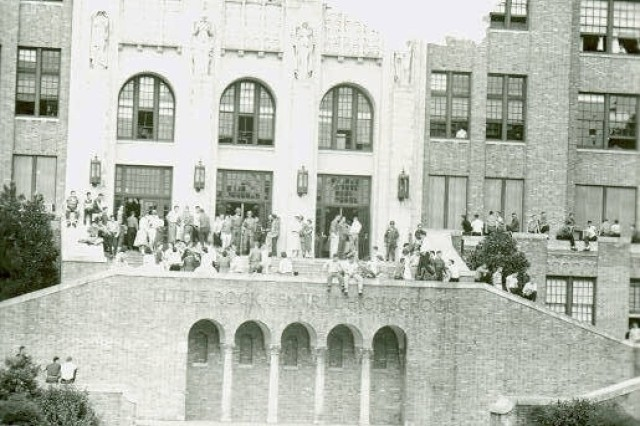 Soldiers keep watch over the students crowded on the steps of Little Rock Central High School.  