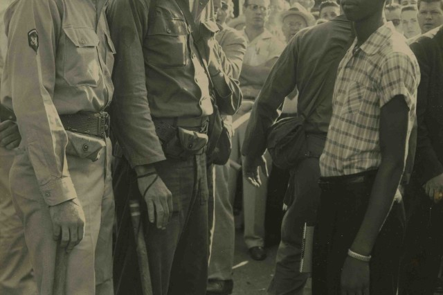Prior to the execution of the Executive Order for Federal Troops, Little Rock Nine member Terrence Roberts faces Arkansas National Guard troops after being denied entry to Central High School, September 3, 1957. Central High Museum Historical Collections/UALR Archives