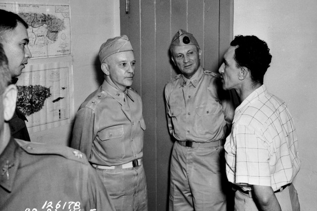 Mr. Gonzalo Soanes, mayor of Caguas, explains how his town conducted blackouts to Lt. Col. F. Parra, Maj. Gen. Collins, and Lt. Gen. Andrews, Puerto Rico, November 1941.