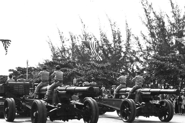 Rear view - 155 mm. Guns of the 51st Coast Artillery passing in review at the 4th of July Parade, San Juan, Puerto Rico, 1941.
