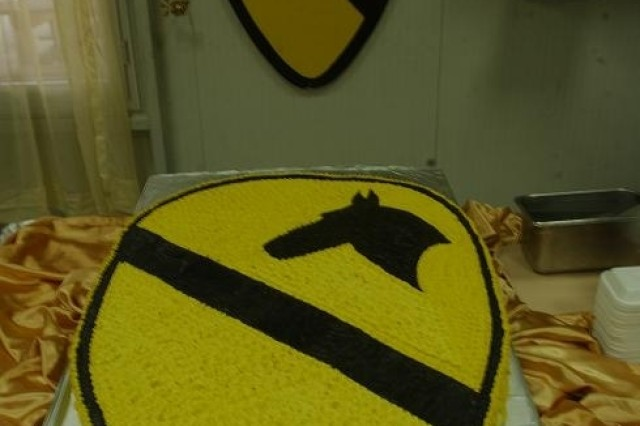 """A cake in the shape of the 1st Cavalry Division shoulder patch was part of the 86th birthday celebration for the division at the Pegasus Dining Facility at Camp Liberty in western Baghdad Sept. 13. """""""