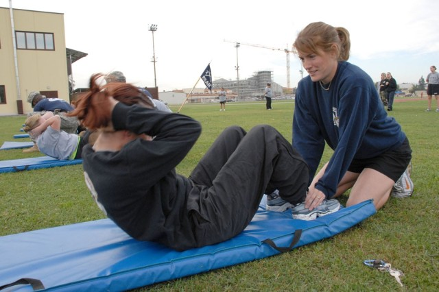 """Nearly 50 spouses of Soldiers from the 2nd Battalion, 503rd Airborne, 173rd Brigade Combat Team recently participated in a day of Army training, including a PT test to Army standards, jump tower, first aid and M-16 training. """"We wanted to bring together the wives of deployed Soldiers ... it builds morale and fosters new friendships in the community,"""" said Cristin Pike, 173rd ABCT family readiness support assistant."""