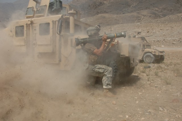 After pinpointing the Taliban's position, Staff Sgt. Jason Geranen fires an AT4 rocket at them.