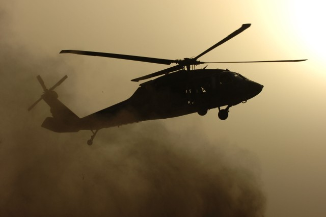 A UH-60 Black Hawk helicopter departs COB Speicher.