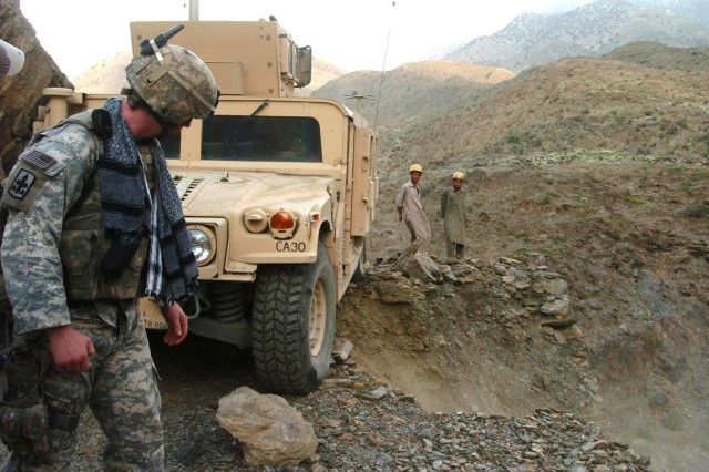 2nd Lt. Jonathan Reabe gets an adrenalin rush and assesses the situation after the road crumbled beneath his Humvee in Titin Valley.