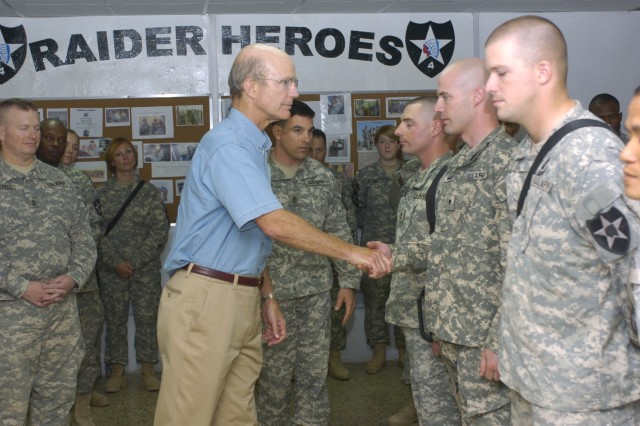 Secretary of the Army Pete Geren shakes hands with Soldiers of the Stryker Brigade Combat Team in Taji, Iraq, Sept. 13.