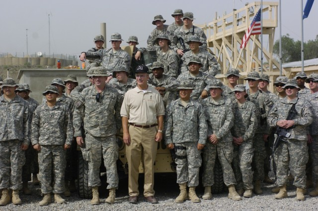Secretary of the Army Pete Geren takes a few moments for a photo opportunity with Soldiers deployed to Taji, Iraq, Sept. 13. The Secretary spent two days visiting with Soldiers in Iraq during his five-day trip through Afghanistan, Kuwait, Iraq and Germany. ""