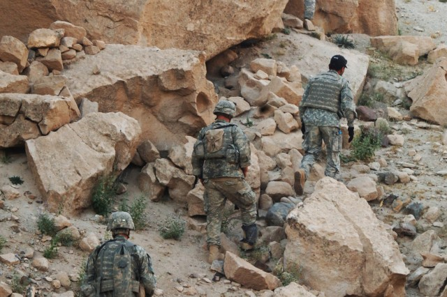 Soldiers search for extremists in the surrounding hills.