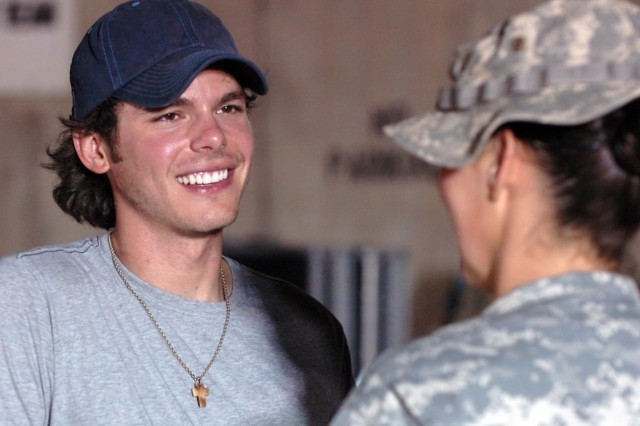 "Soldiers with 3rd ""Grey Wolf"" Brigade Combat Team, 1st Cavalry Division, got the chance to talk to and get autographs from country singer Granger Smith, during his visit to Forward Operating Base Warhorse, outside of Baqouba, Iraq, Sept. 23."