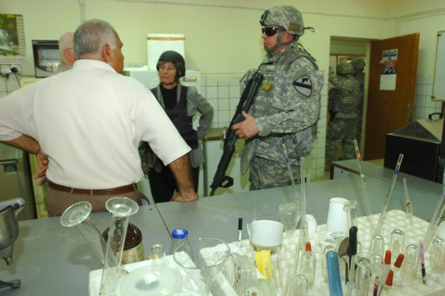 A faculty member (left) from the University of Baghdad's College of Agriculture speaks with Dr. Rebecca Burt (center), a soil science advisor for the U.S. Department of Agriculture and Hermosa, S.D. native Lt. Col. Harvey Fitzgerald, senior agri-business advisor with the 1st Brigade Combat Team, 1st Cavalry Division Embedded Provincial Reconstruction Team, during a tour of the university's dairy research facility lab in Abu Ghraib, Iraq Sept. 22.