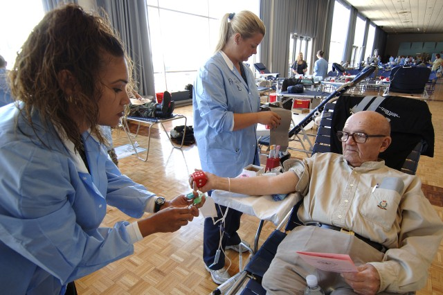 Retired Army Capt. George H. Froemke donates blood during a blood drive at the U.S. Air Force Academy in Colorado Sept. 19. Capt. Froemke is a veteran of World War II, Korea and Vietnam. Blood collected will benefit wounded U.S. troops in Iraq and Afghanistan.