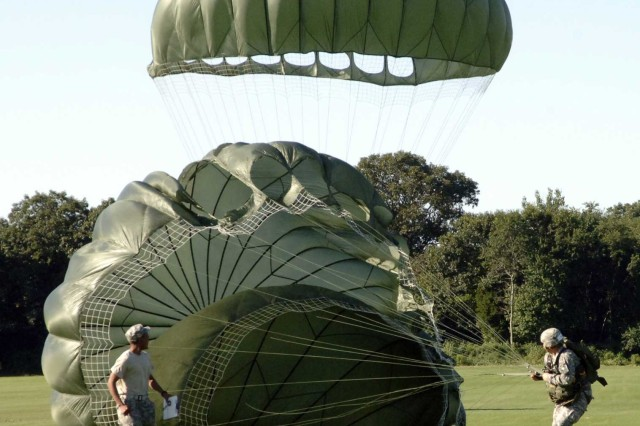 A competitor at the Rhode Island National Guard's international military parachute competition lands at North Kingstown, R.I., Aug. 11. Representatives from the United Kingdom, Thailand, Greece, Macedonia, Germany, Bulgaria, Uruguay, Peru, Bolivia, Ecuador, and El Salvador attended. National Guard units in turn, travel to many countries to conduct combined training exercises and strengthen military-to-military ties.