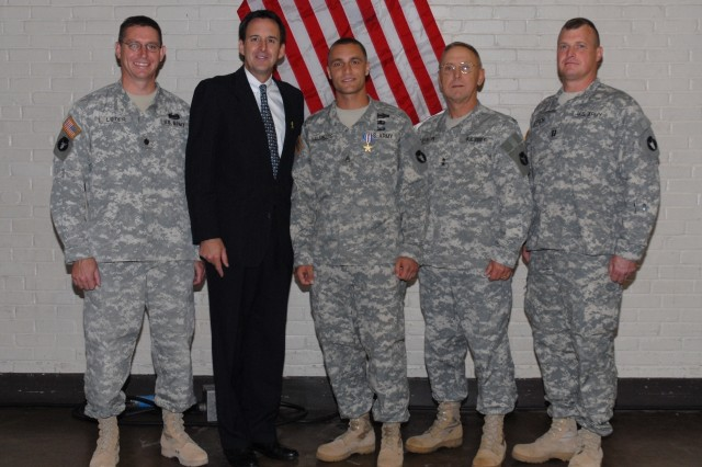 Accompanied by his chain of command, Staff Sgt. Chad Malmberg was awarded the Silver Star for gallantry in action by Minnesota Governor Tim Pawlenty and 34th Infantry Division commander Maj. Gen. Rick Erlandson at a presentation ceremony Sept. 22.